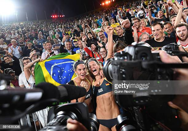 Laura Ludwig and Kira Walkenhorst of Germany celebrate winning gold during the Beach Volleyball Women's Gold medal match against Agatha Bednarczuk...