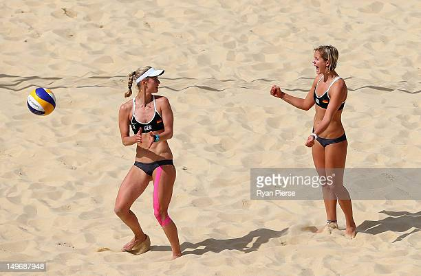 Laura Ludwig and Sara Goller of Germany celebrate during the Women's Beach Volleyball preliminary match between Germany and the Netherlands on Day 6...