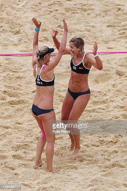 Laura Ludwig and Sara Goller of Germany celebrate during Women's Beach Volleyball Preliminary match between Germany and Australia on Day 2 of the...