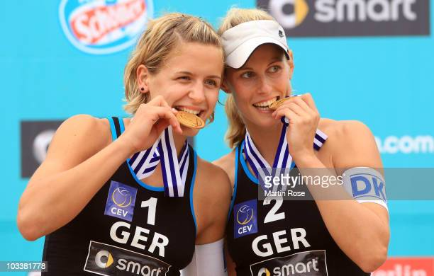 Laura Ludwig and Sara Goller of Germany present their gold medals during the medal ceremony of the European Beach Volleyball Championship Final on...
