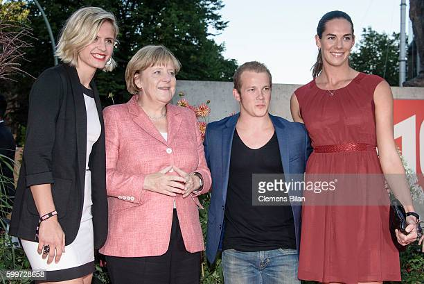 Laura Ludwig, Angela Merkel, Fabian Hambuechen and Kira Walkenhorst attend the BILD100 event on September 6, 2016 in Berlin, Germany.