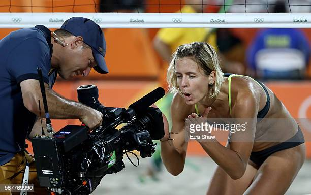 Laura Ludwig of Germany blows kisses into the camera celebrating the vitory in the Women's Beach Volleyball Preliminary Pool D against Jamie Lynn...
