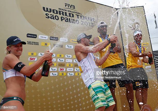 Laura Ludwig of Germany Casey Jennings of United States Pedro Salgado and Bruno Schmidt of Brazil celebrate during the awards ceremony in the day six...