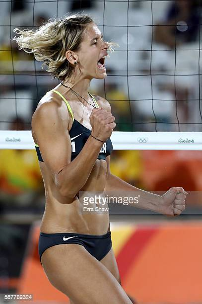 Laura Ludwig of Germany celebrates a point during the Women's Beach Volleyball Preliminary Pool D against Jamie Lynn Broder and Kristina Valjas of...