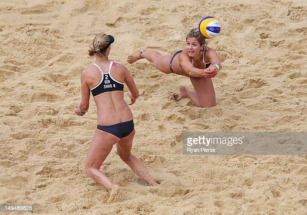 Laura Ludwig of Germany dives for the ball as Sara Goller of Germany looks on during Women's Beach Volleyball Preliminary match between Germany and...