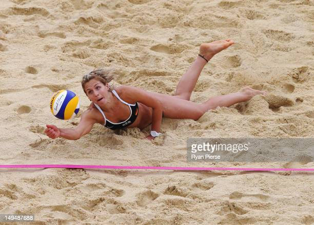 Laura Ludwig of Germany dives for the ball during Women's Beach Volleyball Preliminary match between Germany and Australia on Day 2 of the London...