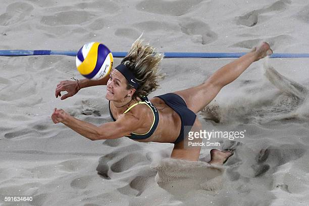 Laura Ludwig of Germany plays a shot during the Beach Volleyball Women's Gold medal match against Agatha Bednarczuk Rippel of Brazil and Barbara...