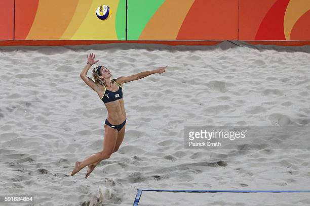 Laura Ludwig of Germany serves the ball during the Beach Volleyball Women's Gold medal match against Agatha Bednarczuk Rippel of Brazil and Barbara...