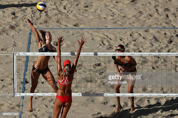 Laura Ludwig of Germany spikes the ball against Anouk VergeDepre of Switzerland during a Women's Round of 16 match between Switzerland and Germany on...
