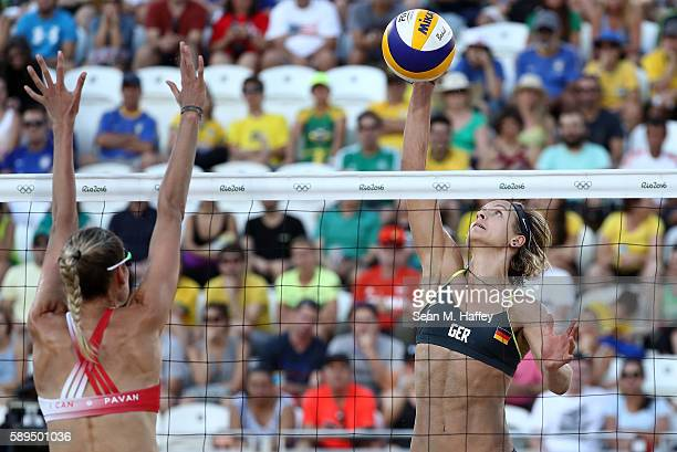 Laura Ludwig of Germany spikes the ball against Sarah Pavan of Canada during a Women's Quarterfinal match between Canada and Germany on Day 9 of the...