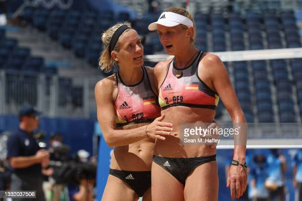 Laura Ludwig of Team Germany and Margareta Kozuch react after the play against Team United States during the Women's Quarterfinal beach volleyball on...