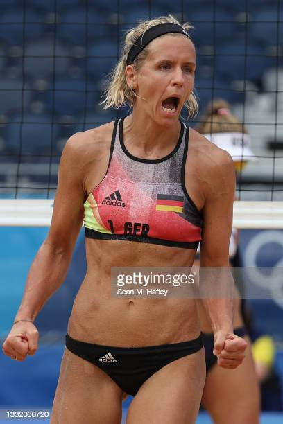 Laura Ludwig of Team Germany celebrates after the play against Team United States during the Women's Quarterfinal beach volleyball on day eleven of...
