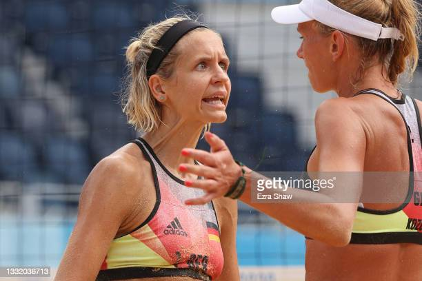 Laura Ludwig of Team Germany celebrates with Margareta Kozuch after the play against Team United States during the Women's Quarterfinal beach...