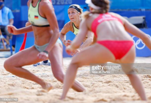 Laura Ludwig of Team Germany competes against Team Switzerland during the Women's Preliminary - Pool F on day one of the Tokyo 2020 Olympic Games at...
