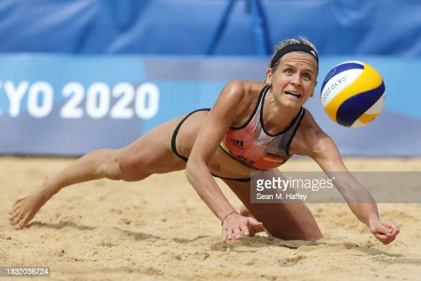 Laura Ludwig of Team Germany dives for the ball against Team United States during the Women's Quarterfinal beach volleyball on day eleven of the...