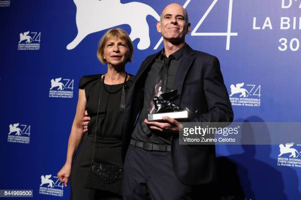Laura Maoz and Samuel Maoz pose with the Silver Lion Grand Jury Prize Award for 'Foxtrot' at the Award Winners photocall during the 74th Venice Film...