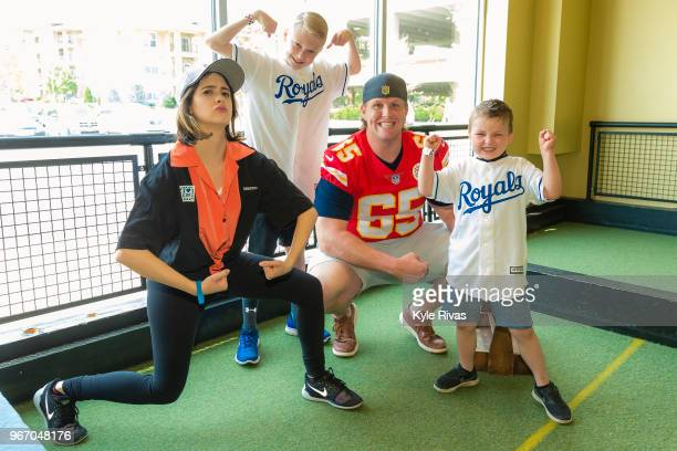 Laura Marano and Jordan Devey pose for a photo with patients from Children's Mercy Hospital while participating in bocce ball at Pinstripes during...