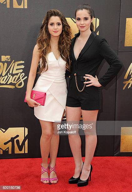 Laura Marano and sister Vanessa Marano arrive at the 2016 MTV Movie Awards at Warner Bros Studios on April 9 2016 in Burbank California