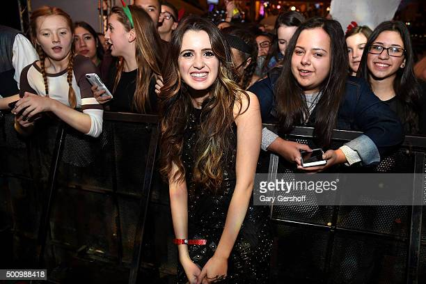Laura Marano poses with crowd members at Z100's Jingle Ball 2015 Z100 CocaCola All Access Lounge Show at Hammerstein Ballroom on December 11 2015 in...