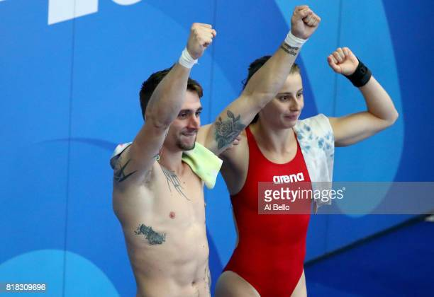 Laura Marino and Mattieu Rosset of France celebrate winning the gold medal during the Mixed Diving Team final on day five of the Budapest 2017 FINA...