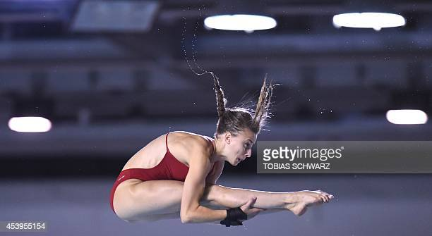 Laura Marino of France poses after the women's 10m Platform final at the 32nd LEN European swimming championships on August 22 2014 in Berlin Marino...