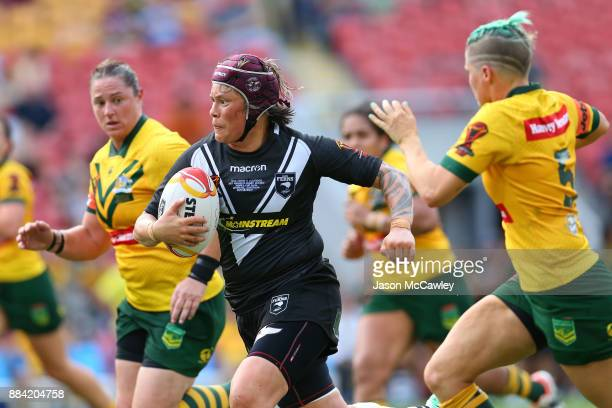 Laura Mariu of the Ferns offloads the ball during the 2017 Rugby League Women's World Cup Final between Australia and New Zealand at Suncorp Stadium...
