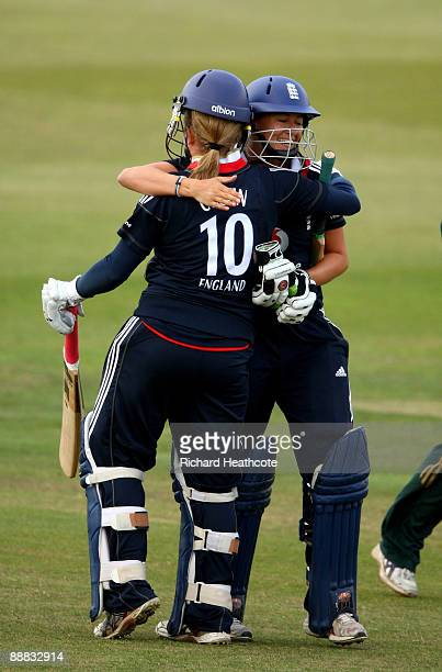 Laura Marsh and Holly Colvin of England celebrate hitting the winning run off the final ball of the innings during the One Day International match...