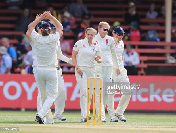 Laura Marsh of England celebrates the wicket of Alyssa Healy during day three of the Women's Test match between Australia and England at North Sydney...