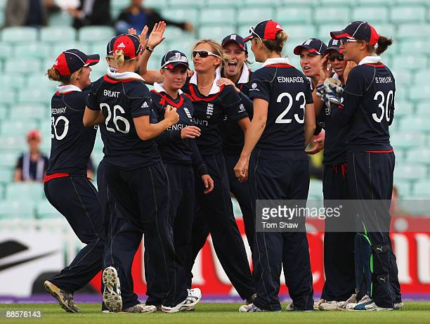 Laura Marsh of England celebrates the wicket of Leah Poulton of Australia with team mates during the ICC Women's World Twenty20 Semi Final between...