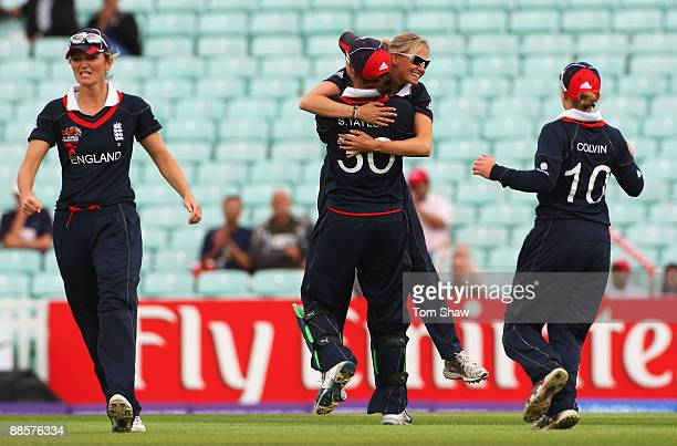 Laura Marsh of England celebrates the wicket of Leah Poulton of Australia with team mate Sarah Taylor and Charlotte Edwards during the ICC Women's...