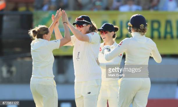 Laura Marsh of England celebrates the wicket of Nicole Bolton of Australia during day two of the Women's Test match between Australia and England at...