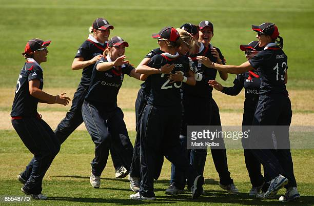Laura Marsh of England celebrates with her team after taking a wicket during the ICC Women's World Cup 2009 final match between England and New...