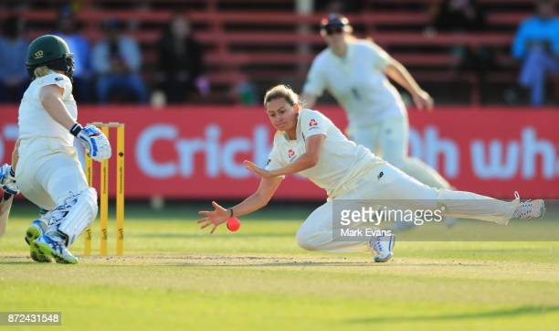 Laura Marsh of England fields from her own bowling during day two of the Women's Test match between Australia and England at North Sydney Oval on...
