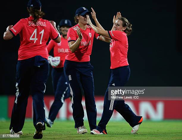 Laura Marsh of England is congratulated on the wicket of Muneeba Ali of Pakistan after she was caught by Katherine Brunt of England during the...