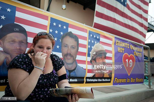 Laura Marshall of Phoenix Arizona sits in front of a photograph of her cousin Garret Zuppiger who was one of the 19 firefighters killed in a wildfire...