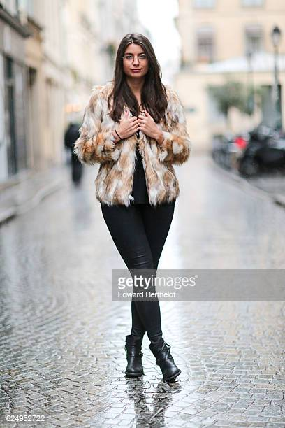 Laura Martin is wearing Minelli shoes Zara pants a The Kooples top glasses and a Hollister faux fur coat on November 21 2016 in Paris France