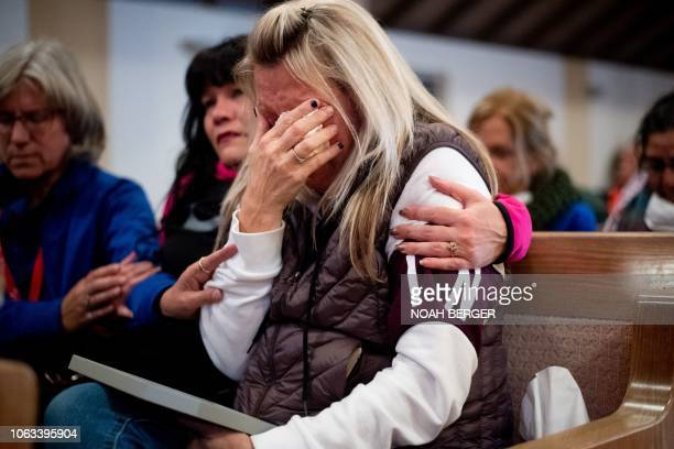 Laura Martin mourns her father TK Huff who died in the Camp Fire during a vigil on Sunday November 18 in Chico California The blaze has killed at...