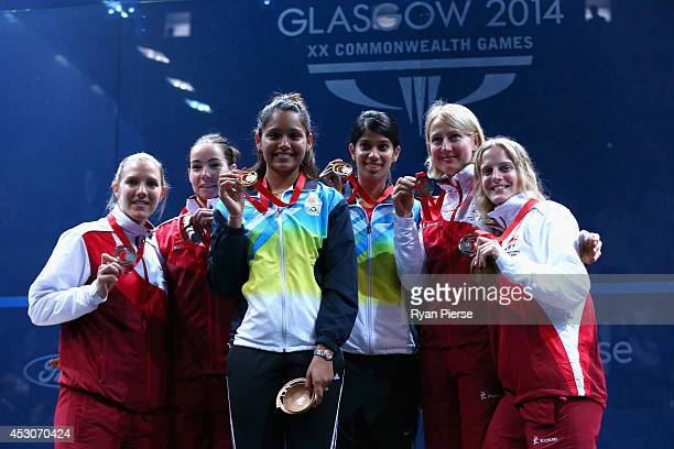 Laura Massaro and Jenny Duncalf of England Dipika Pallikal and Joshana Chinappa of India and Alison Waters and Emma Beddoes of England celebrate with...