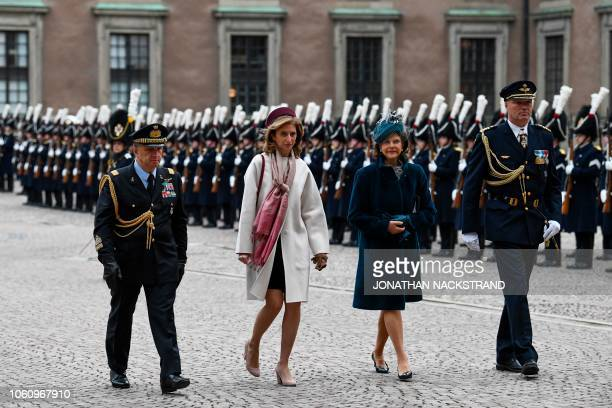 Laura Mattarella daughter of the President of Italy and Queen Silvia of Sweden review an honor guard on November 13 2018 at the Royal Palace in...