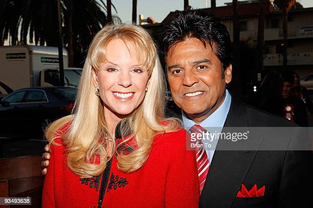 Laura McKenzie and Erik Estrada attend the 2009 Hollywood Christmas Parade on November 29 2009 in Hollywood California