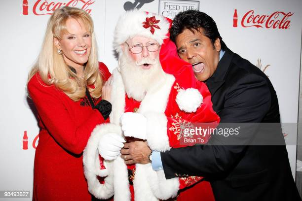 Laura McKenzie Santa Clause and Erik Estrada attend the 2009 Hollywood Christmas Parade on November 29 2009 in Hollywood California