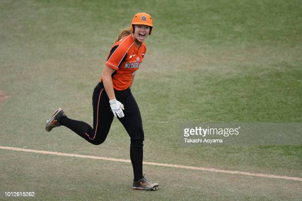 Laura Michelle Wissink of Netherlands reacts after drawing a walk in the seventh inning against Mexico during their Preliminary Round match at ZettA...