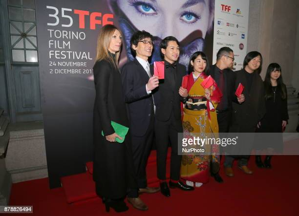 Laura Milani President of the Turin Cinema Museum with the cast of one of the films in competition during the opening ceremony of he 35nd edition of...