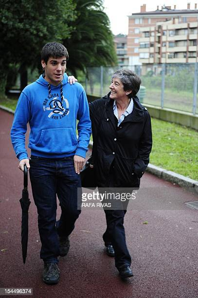 Laura Mintegi candidate of proindependence Basque political parties coalition Euskal Herria Bildu walks with her son after voting on October 21 in...