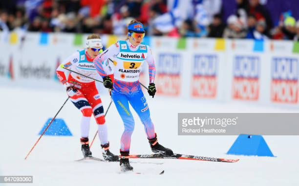 Laura Mononen of Finland and Astrid Uhrenholdt Jacobsen of Norway compete during the Women's Cross Country 4x5km Relay at the FIS Nordic World Ski...