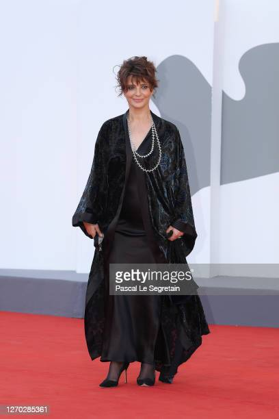 """Laura Morante walks the red carpet ahead of the Opening Ceremony and the """"Lacci"""" red carpet during the 77th Venice Film Festival at on September 02,..."""
