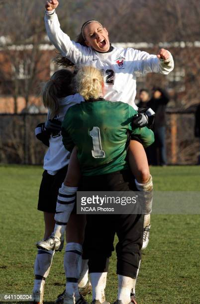Laura Morcone of Oneonta State University lifts teammate Amanda LaPolla in the air in celebration after defeating the University of Chicago battle...