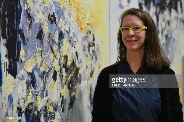 Laura Morris director or archives and exhibition of the Joan Mitchell fondation poses on December 18 in the Fonds Helene et Edouard Leclerc during...