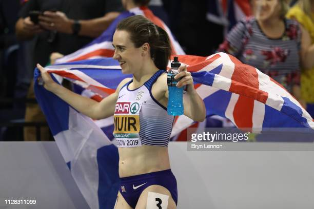 Laura Muir of Great Britain celebrates winning gold in the final of the women's 3000m on day one of the 2019 European Athletics Indoor Championships...