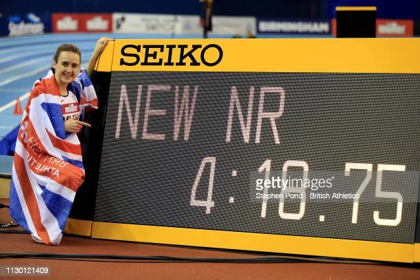 Laura Muir of Great Britain celebrates winning the Women's One Mile in a new British record time of 4 minutes 1874 seconds during the Muller Indoor...
